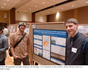 Photo of Adam and Brian at poster session