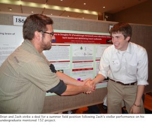 Photo of Brian and Zach at poster session