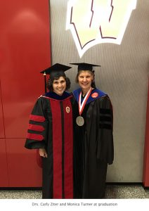 Photo of Carly and Monica graduation