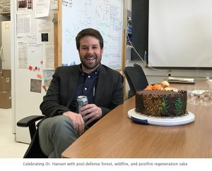 Photo of Dr. Winslow Hansen with cake