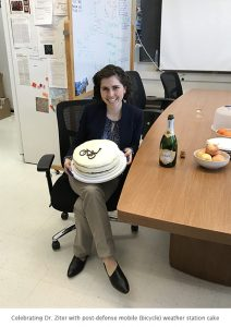 Photo of Dr. Carly Ziter with cake