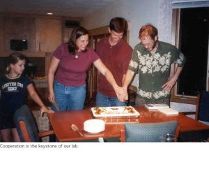 Photo of cutting cake at lab party